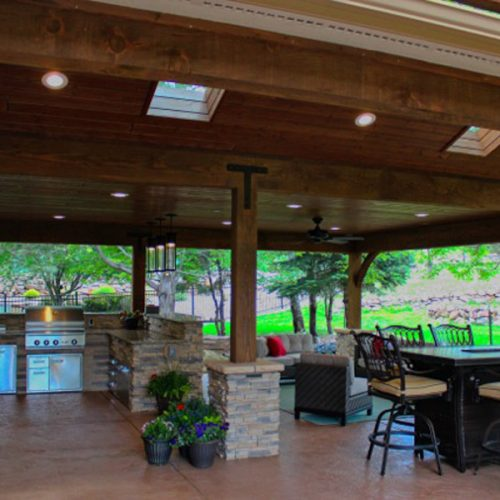 Gable roof, stamped and colored concrete, pergola, outdoor kitchen, Delta Heat BBQ, lower Peregrine