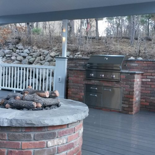 Timbertech deck with patio cover, custom firepit, built-in grill, outdoor kitchen, Delta Heat BBQ grill, Broadmoor Bluffs