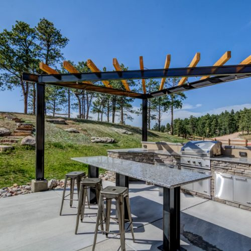 Steel pergola, outdoor kitchen, DCS grill, granite countertop, Monument