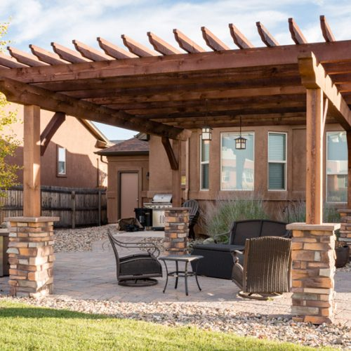 Pergola with lights, stone columns, Colorado Springs