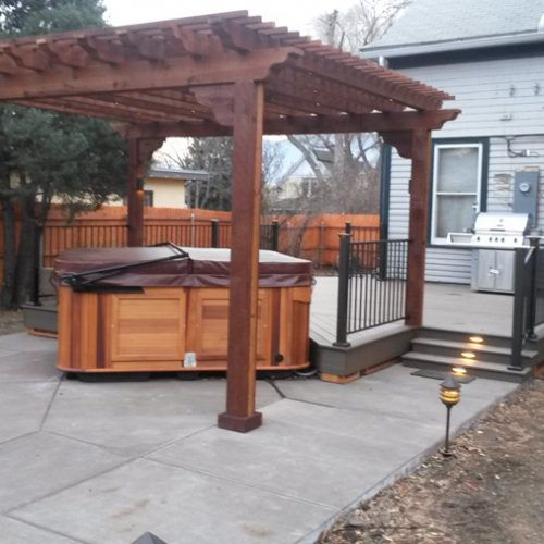 Stamped and colored concrete, hot tub, wood pergola, composite deck, Colorado Springs