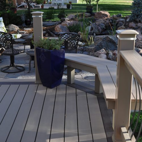 Azek low-maintenance decking, flagstone patio, low-voltage lighting