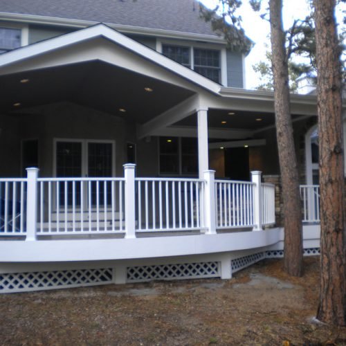 Custom wrought iron railing, outdoor kitchen, patio cover, shed roof, gable roof, waterfall, Black Forest